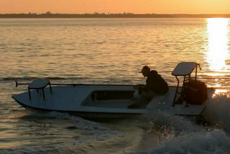 Enjoy a day on this beautifully designed 18' Hell's Bay skiff!