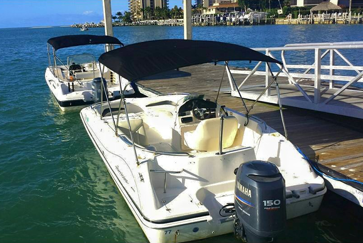 Discover Naples surroundings on this Deck Boat Hurricane boat