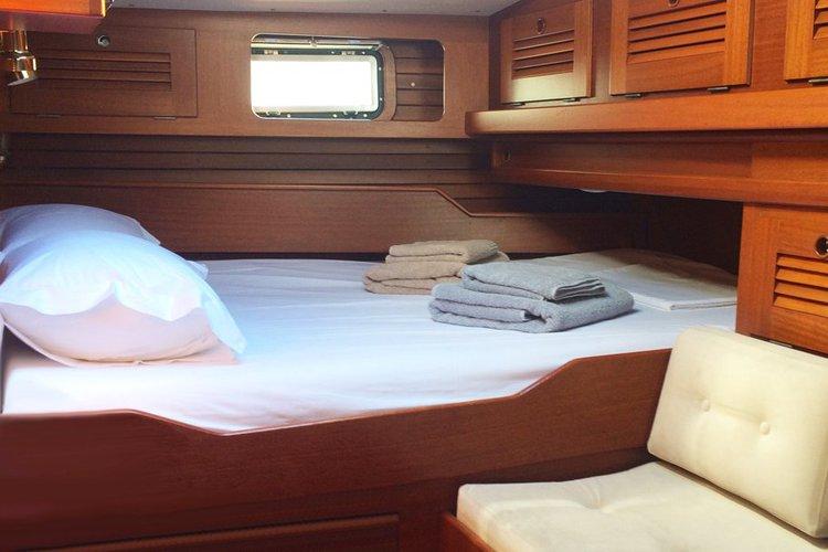 Discover Foinikas surroundings on this 49 Hallberg-Rassy boat