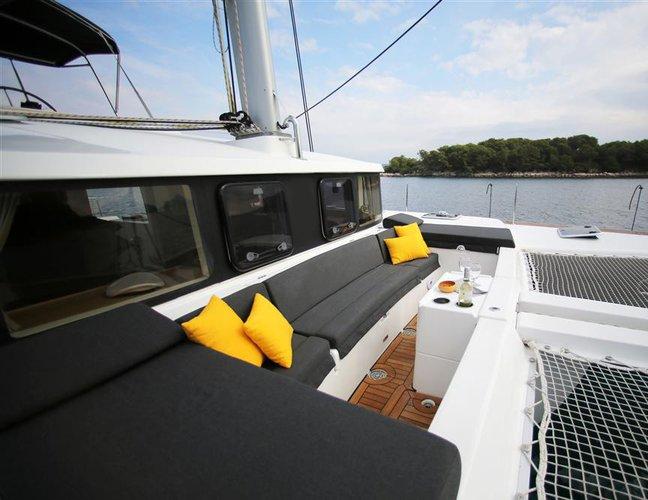 Discover Alcantara surroundings on this 440 Lagoon boat