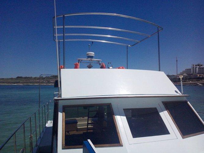Discover St Julian's surroundings on this Custom Custom boat