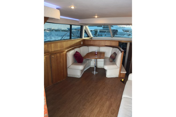 Discover Nassau surroundings on this 42 Convertible Silverton boat