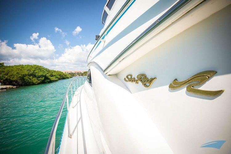 Enjoy luxury and comfort on this Puerto Aventuras motor yacht rental