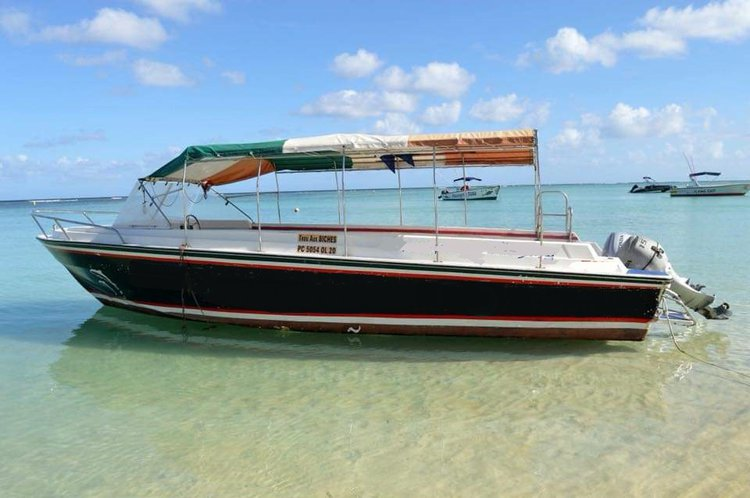 Experience Port Louis on board this elegant motor boat