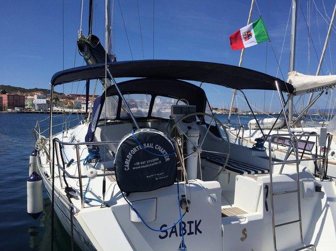 Sail Carloforte, IT waters on a beautiful Beneteau Oceanis 393 Clipper