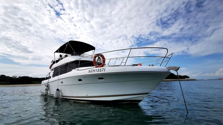 Discover Singapore  in style boating on this motor yacht charter