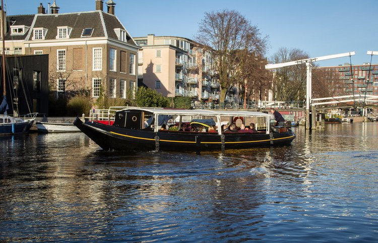 Discover Amsterdam  in style boating on this motor boat rental