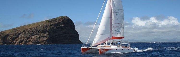 Have fun in the sun on this Grand Bay catamaran charter.