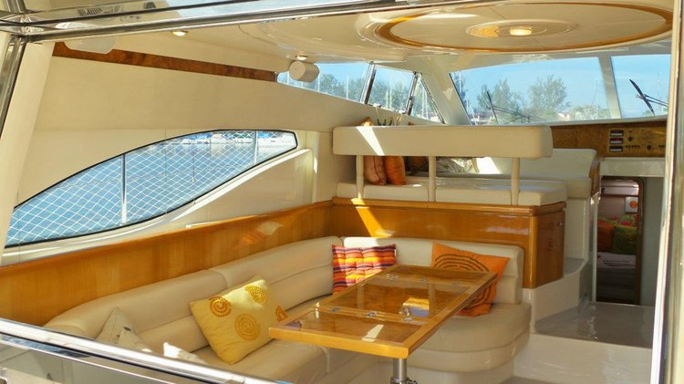 Discover Angra dos Reis surroundings on this 46 Ferretti boat