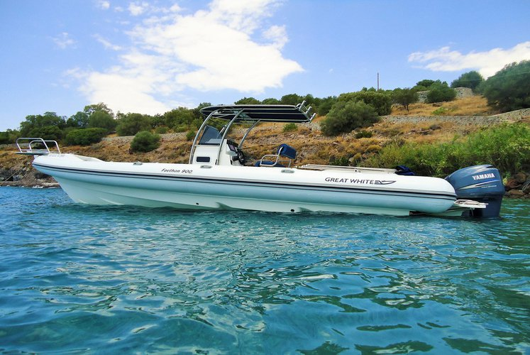 Discover  surroundings on this Faethon 900 Open Great White boat