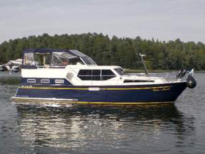 Sail the beautiful waters of Kröslin on this cozy  Aqua Yacht 1200
