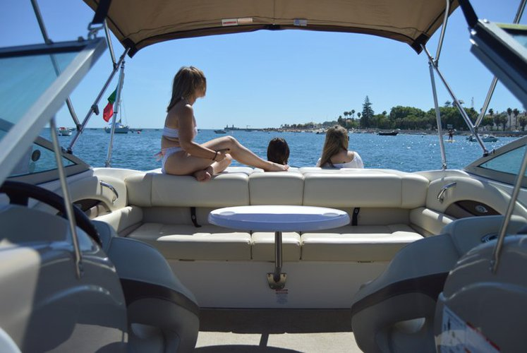 Discover Lisbon surroundings on this 210 SSI CHAPARRAL boat