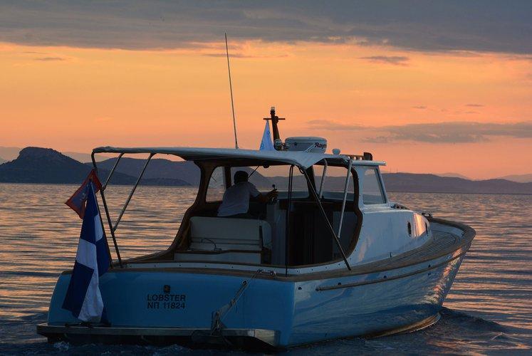 Classic boat rental in Hydra port, Greece
