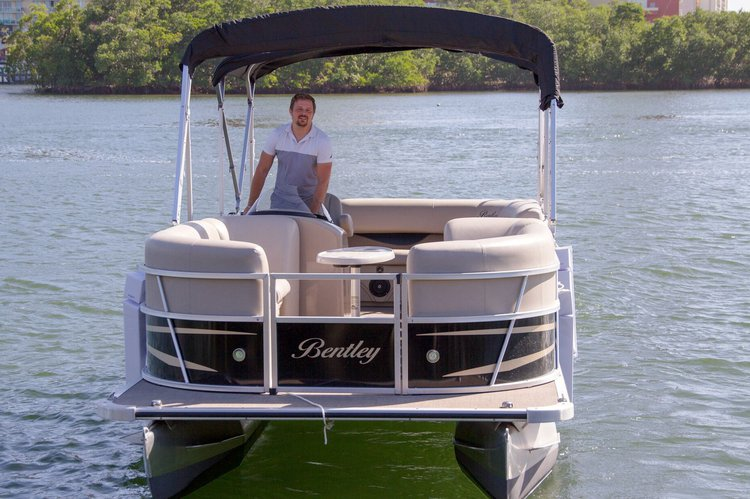 Discover Sunny Isles Beach surroundings on this 240 SE Bentley boat