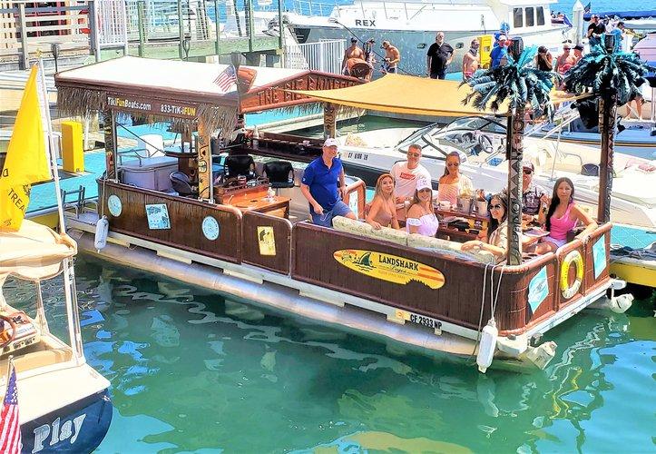 Discover Newport Beach surroundings on this Godfrey Godfrey boat