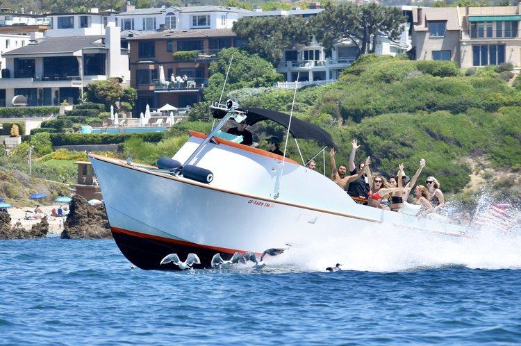 Discover Newport Beach surroundings on this Custom SeaWay boat