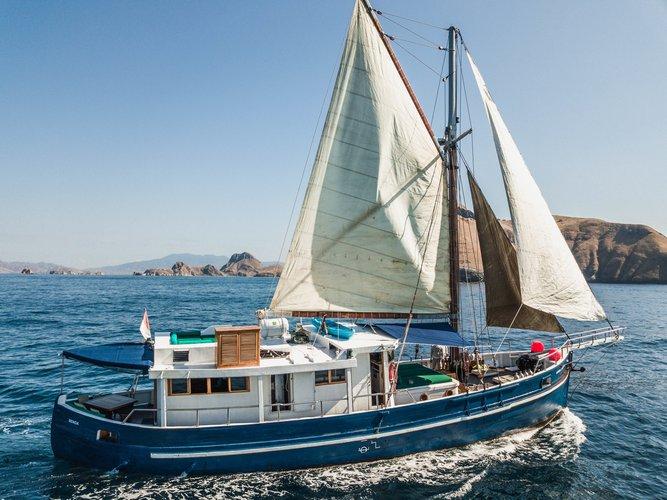 Sail the beautiful waters of Teluk Ambon on this cozy  Motor sailer