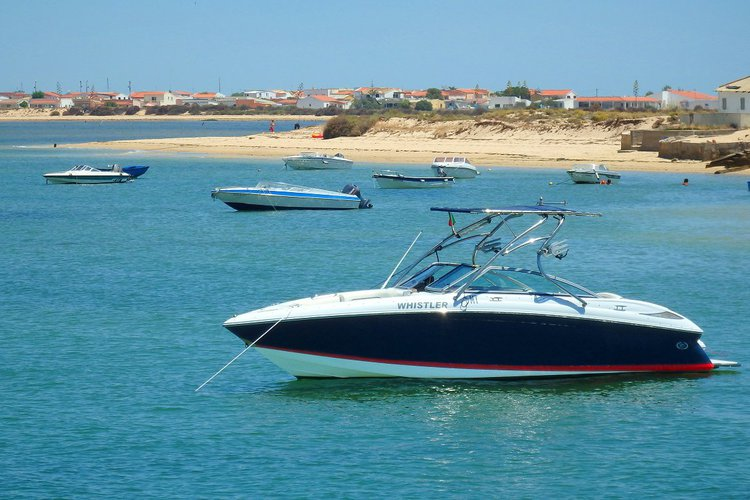 Discover Faro surroundings on this 232 Cobalt boat