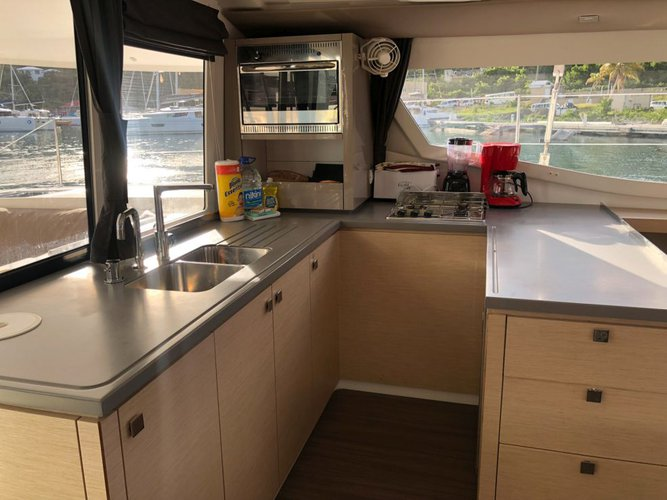 Discover Scrub Island surroundings on this 44 Helia boat