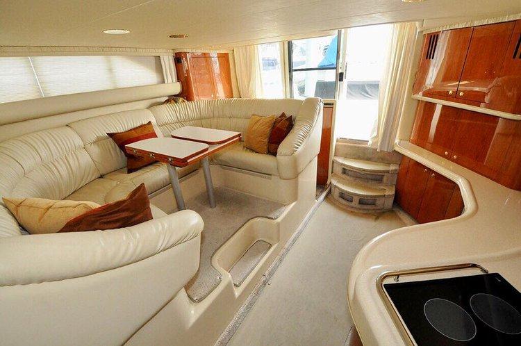 Discover Miami Beach surroundings on this 450 Express Bridge sea ray boat