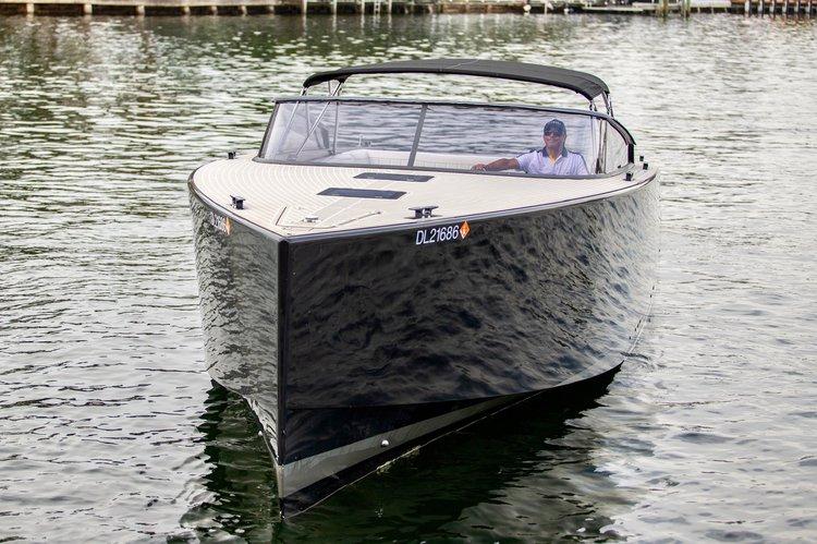 Discover Miami Beach surroundings on this 40 Van Dutch boat