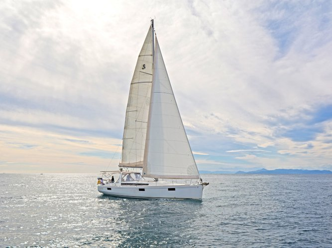 Sail the beautiful waters of Athens on this cozy Beneteau Oceanis 48