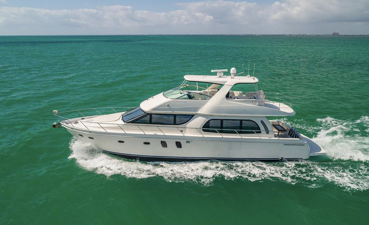 Discover Miami Beach surroundings on this 59 Voyager Flybridge Carver boat
