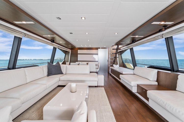 Up to 13 persons can enjoy a ride on this Flybridge boat