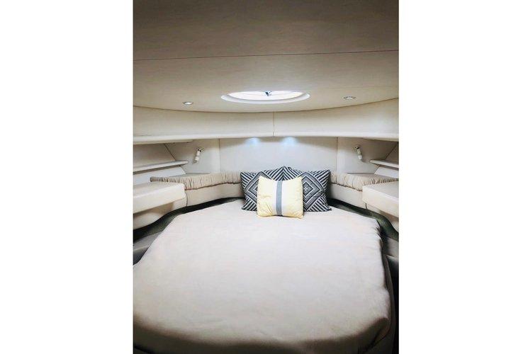 Discover Miami Beach surroundings on this 45 sundance sea ray boat