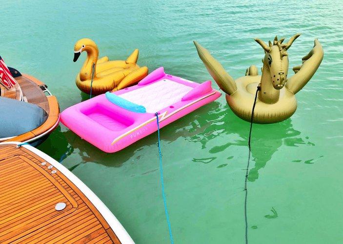 Discover Miami Beach surroundings on this Flybridge Prestige boat