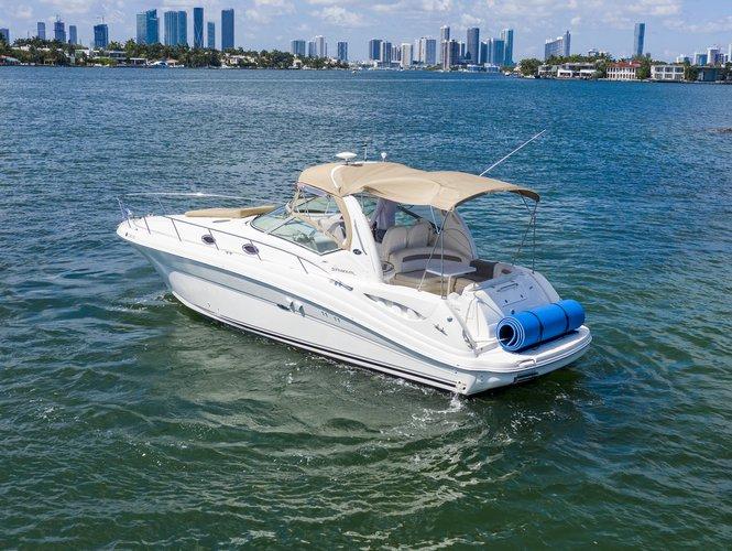 Discover Miami Beach surroundings on this Sundancer 340 Sea Ray boat