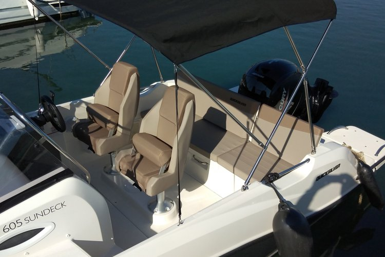 Discover Istra surroundings on this 605 Active Sundeck Quicksilver boat