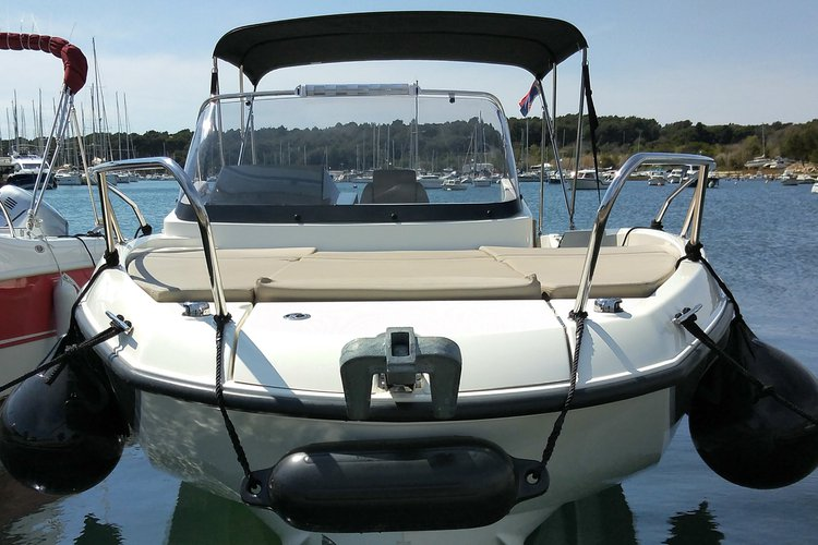 Discover Pula surroundings on this 675 Active Sundeck Quicksilver boat