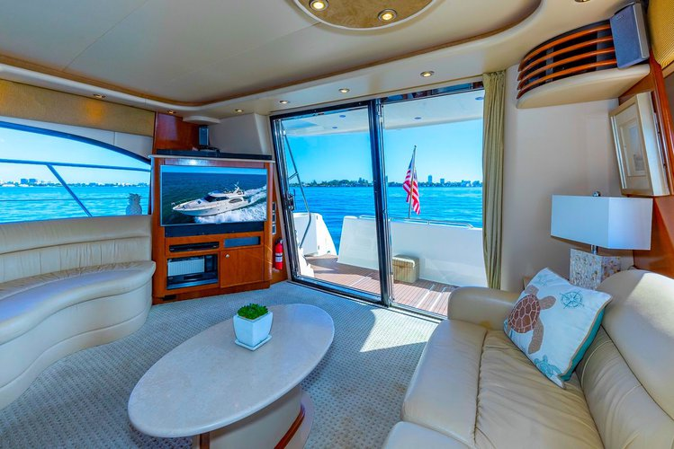 Discover North Bay Village surroundings on this M60 Meridian boat