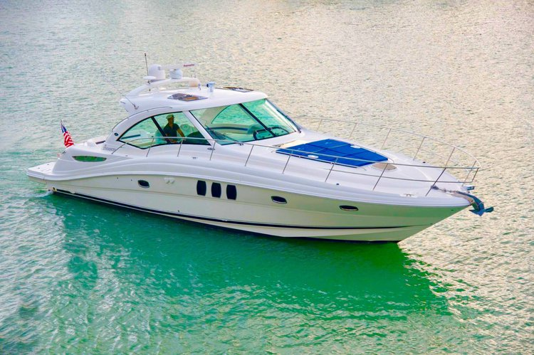Discover Miami Beach surroundings on this Sundancer SeaRay boat