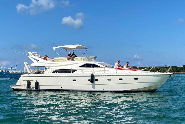 Discover Miami surroundings on this Ferretti Flybridge Ferretti boat