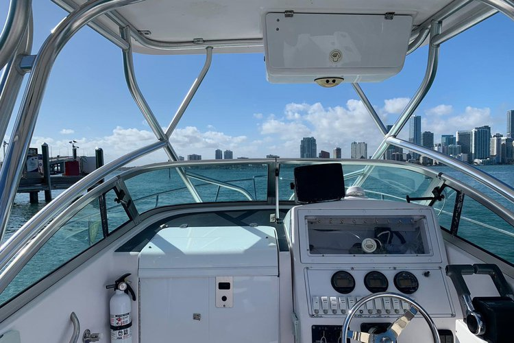Discover Key Biscayne surroundings on this 23 Express Proline boat