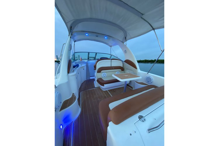 Discover Miami surroundings on this 33ft Sundancer Searay boat