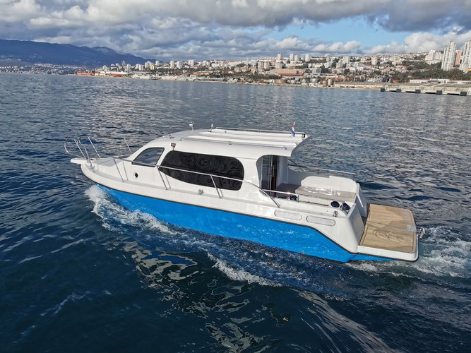 Rent this  AC DC Daycruiser 12.0 for a true nautical adventure