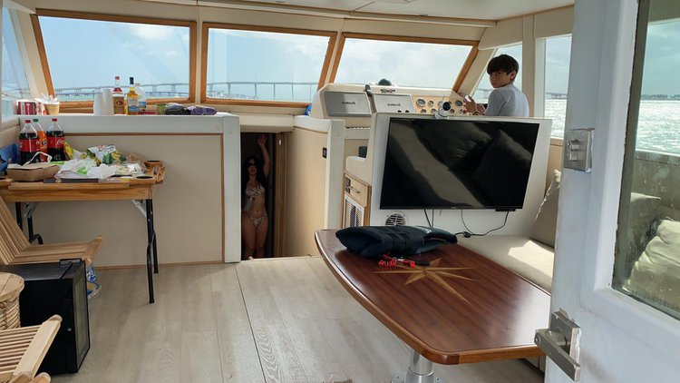 Discover Miami surroundings on this 58 Hattera Yacht boat